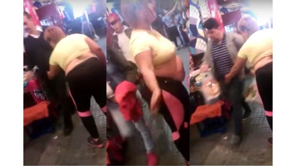 Mujer que baila y le toca sus partes a los hombres