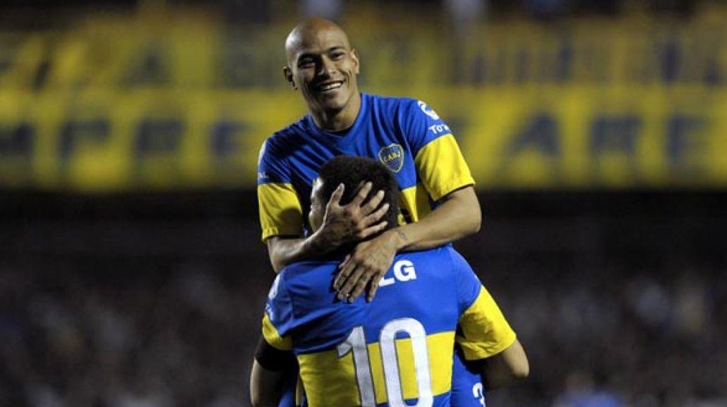 Clemente Rodríguez y Juan Román Riquelme en Boca. El defensor también fue dirigido por Miguel Ángel Russo.