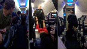 Sacan a una mujer de un avión arrastrando