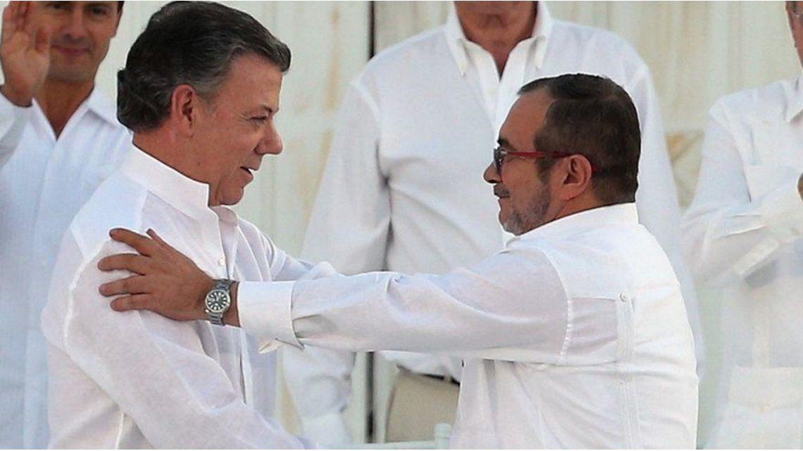 Juan Manuel Santos y Timochenko