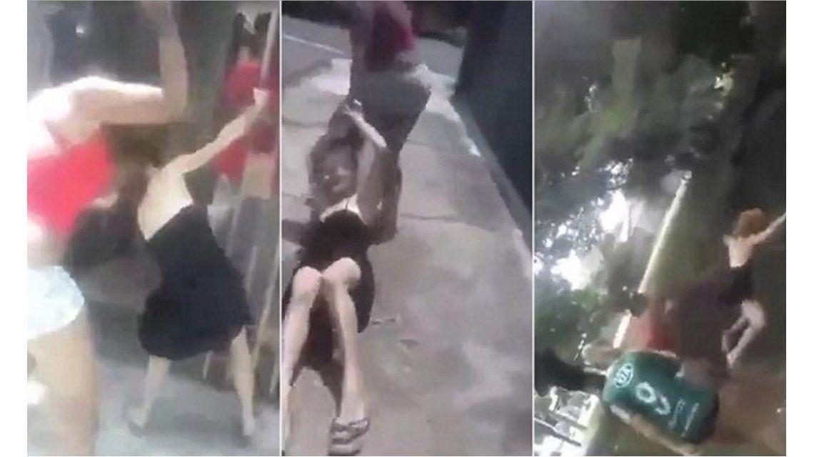 VIDEO: Arrastró de los pelos a la amante de su marido y la tiró desde un puente