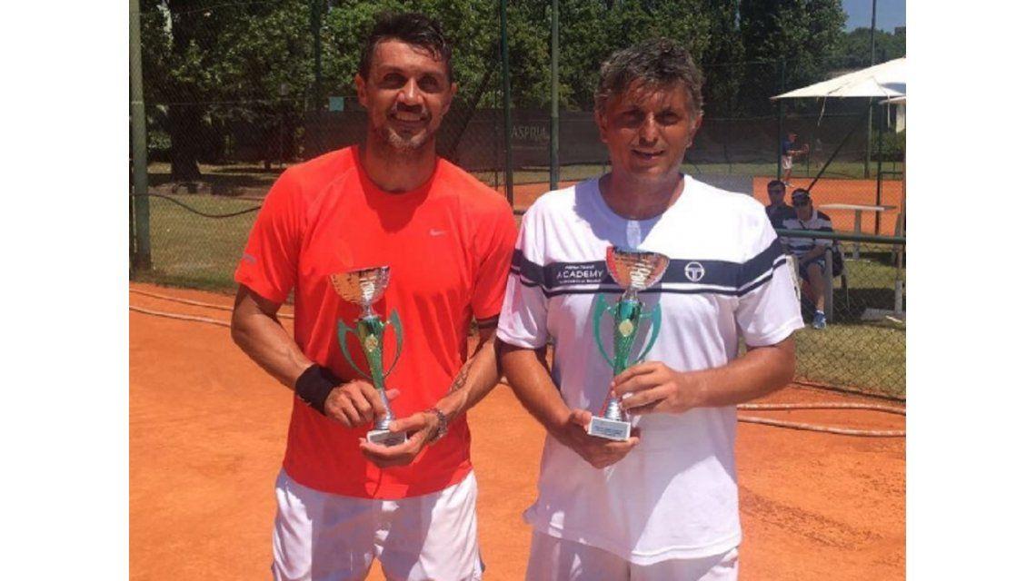 El ex defensor italiano junto a su entrenador y actual pareja de dobles
