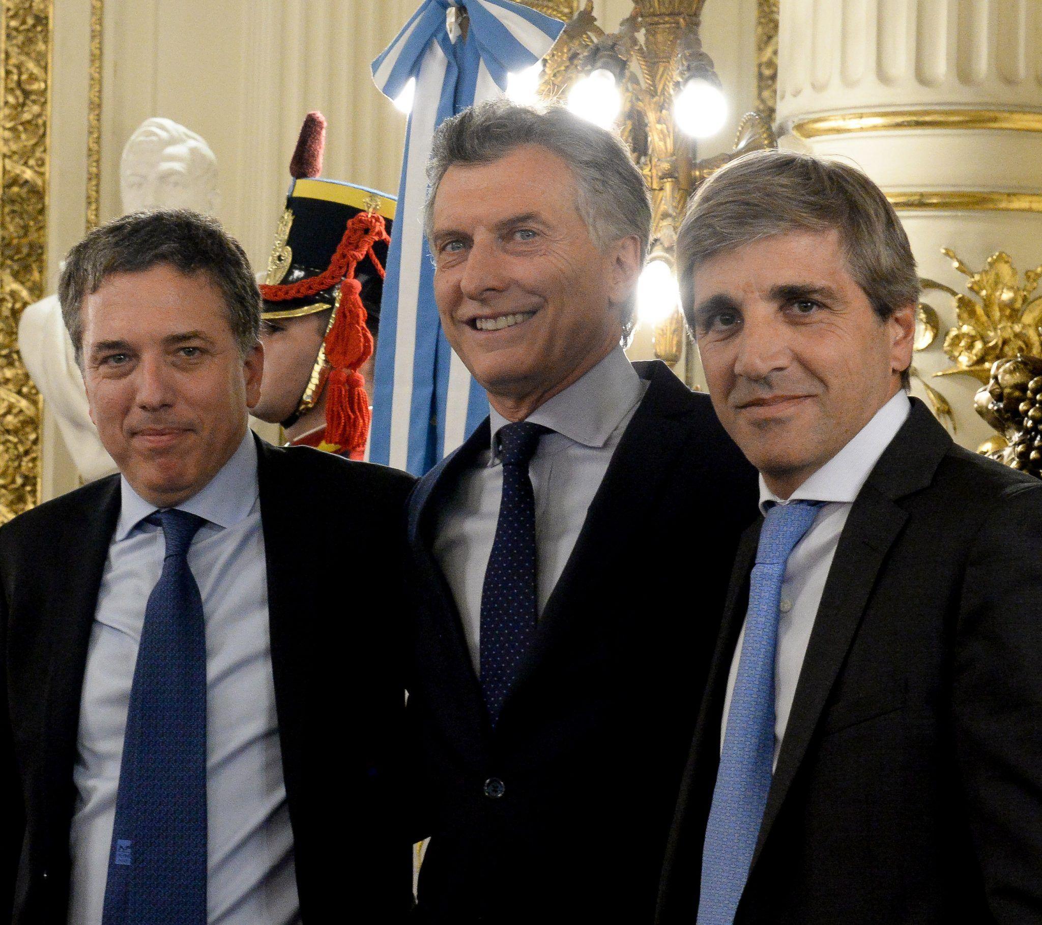 Nicolás Dujovne, Mauricio Macri y Luis Caputo<br>