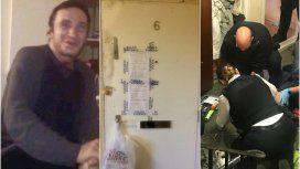Mario Perivoitos, la puerta de su departamento y policías peritando