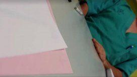 Una captura del video en el que atraparon in fraganti al médico depravado