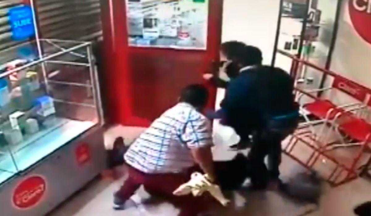Salvaje robo a un local de celulares: una embarazada herida