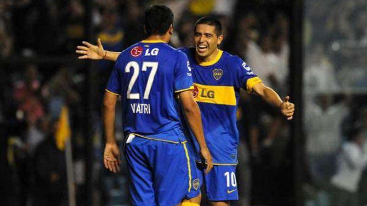 Viatri y Riquelme festejando un gol en Boca