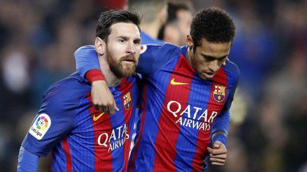 Messi y Neymar con la camiseta de Barcelona<br>