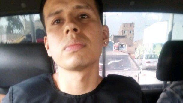 Alexander Delgado al ser trasladado<br>
