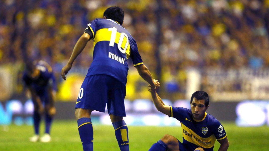 Juan Román Riquelme con Luciano Acosta