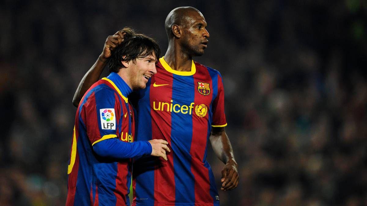 Lionel Messi y Eric Abidal