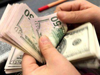 el dolar cerro en $58,06 en el tercer dia del cepo