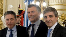 Nicolás Dujovne, Mauricio Macri y Luis Caputo