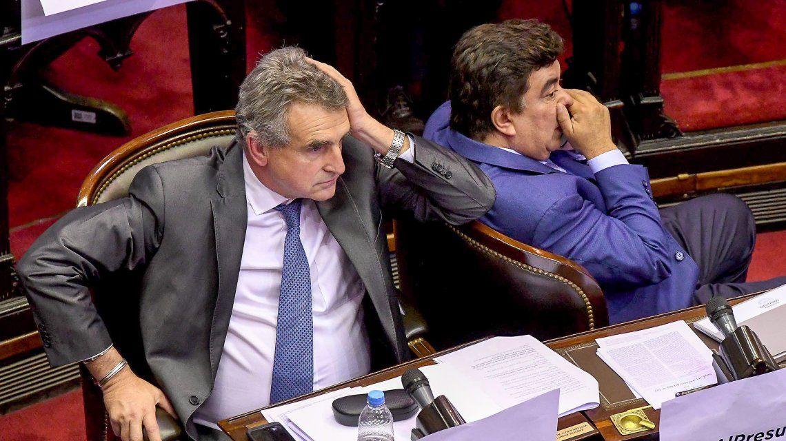 Agustín Rossi junto a Fernando Espinoza