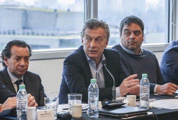 Dante Sica, Mauricio Macri y Jorge Triaca<br>