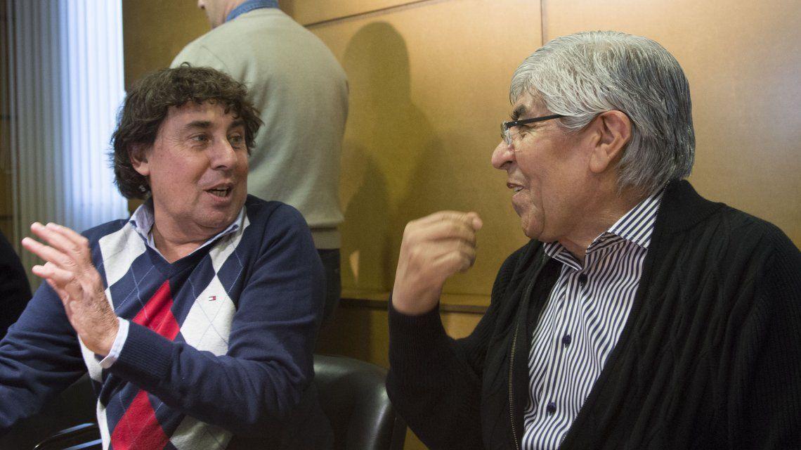 Pablo Micheli y Hugo Moyano