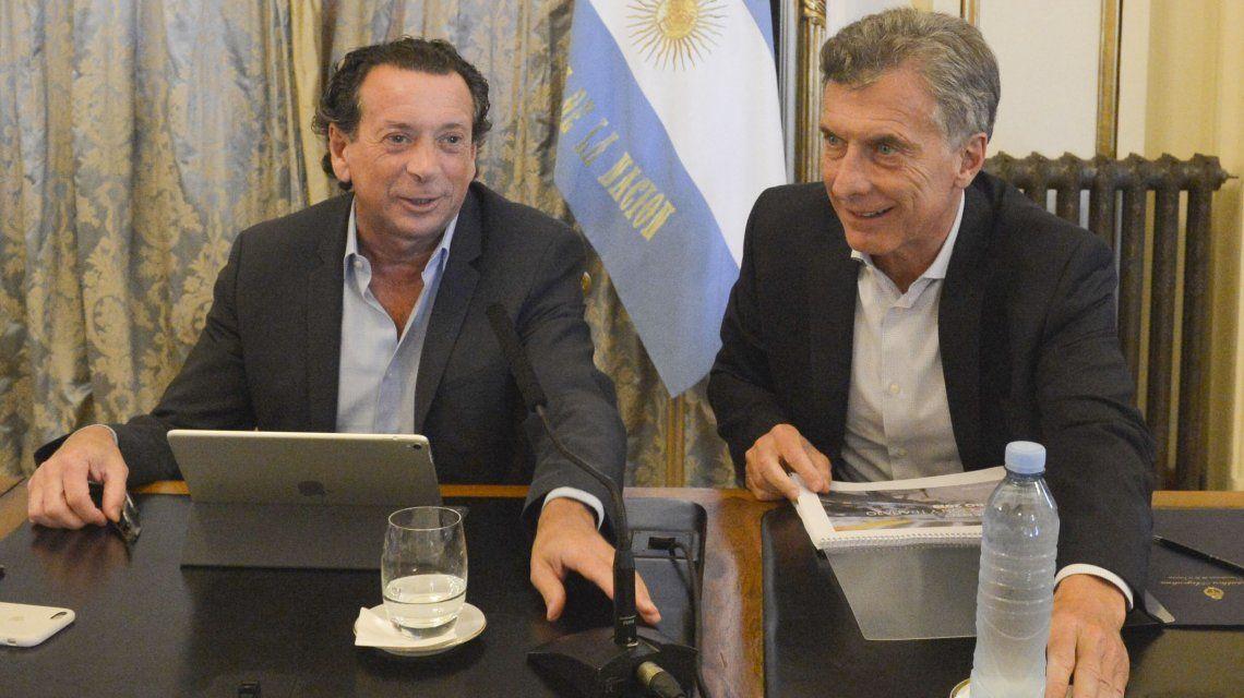 Dante Sica y Mauricio Macri