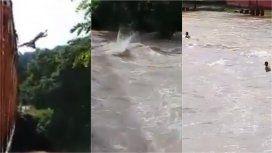 VIDEO: Jóvenes imprudentes se tiraron desde un puente al río en plena crecida