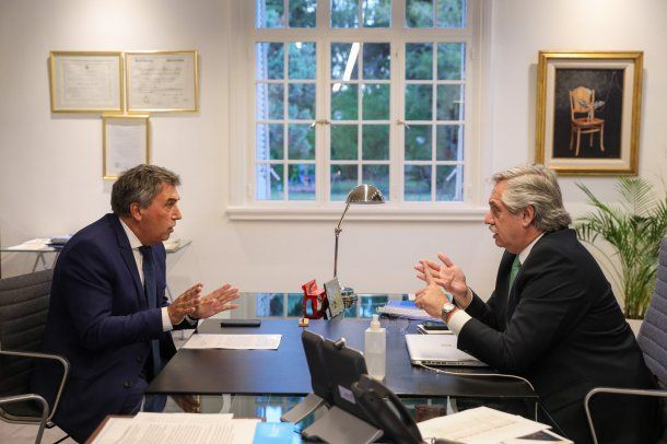 Alberto Fernández y Claudio Ambrosini, titular del Ente Nacional de Comunicaciones (Enacom).