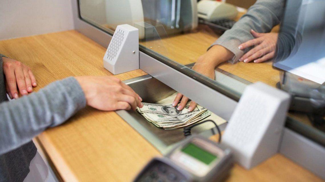 Bancarios cobrarán como mínimo una compensación de 64.500 pesos por su día