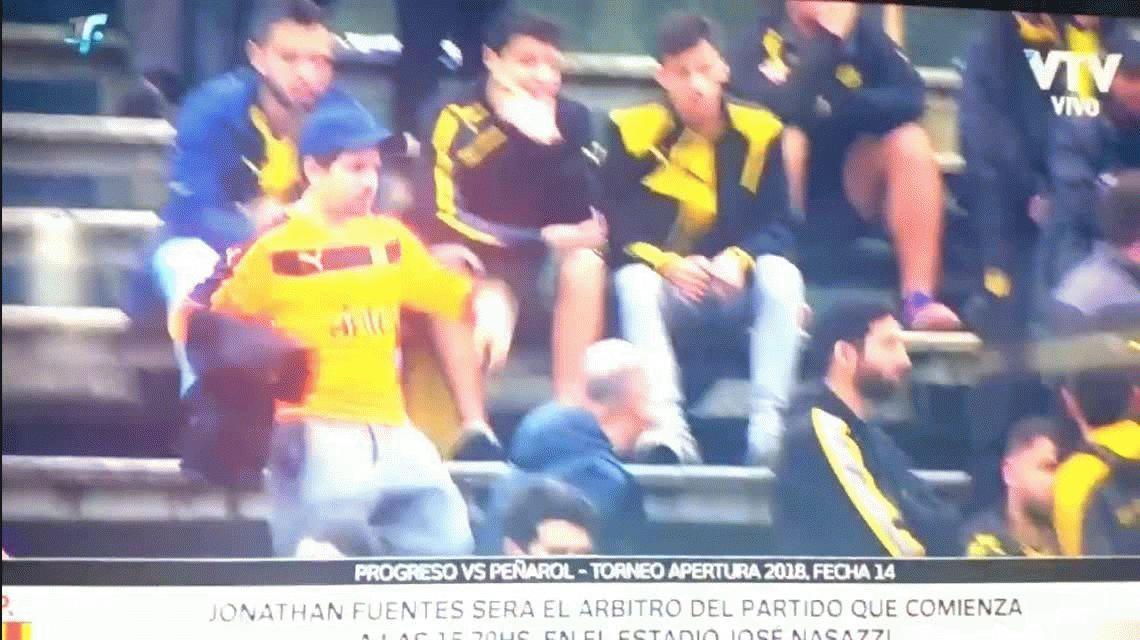 Nunca visto: el arquero de Peñarol no tenía otra camiseta...¡y se la pidió a un hincha!