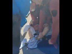 violenta detencion de un muchacho que pedia limosna en puerto madero